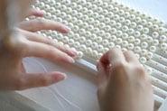 Realisation collier de perles de mer Akoya