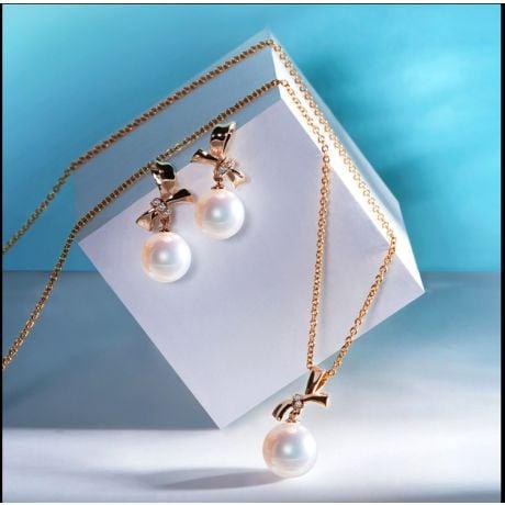 Pendentif Noeud avec ganse. Perle Akoya, Or rose, Diamants