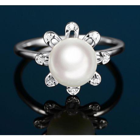 Bague fleur des neiges. Or blanc, pétales de diamants