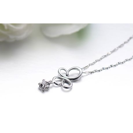Pendentif diamant solitaire - Fleur papillonnante en or blanc