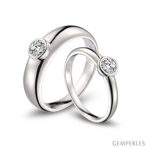 Alliances Couple. Or blanc. Diamants 0.60ct