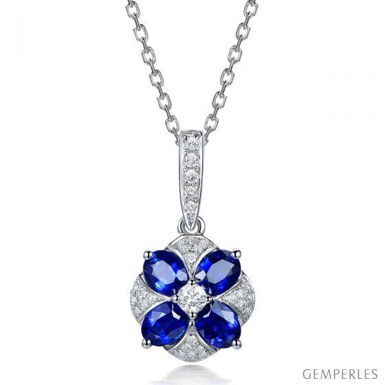 Pendentif solitaire fleur bleue. Or blanc, saphirs et diamants