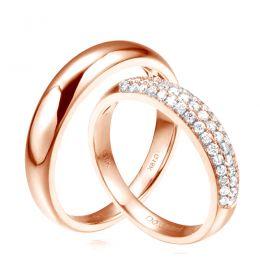 Alliances duo bombées Or rose 18 carats. Sertissage diamants