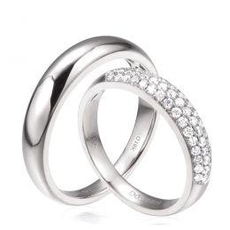 Alliances duo bombées Or blanc 18 carats. Sertissage diamants