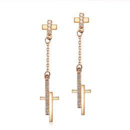 Boucles oreilles croix pendante Or rose diamants 0.21ct