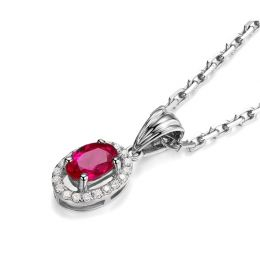 Pendentif Madame Or blanc 18 carats. Rubis ovale diamants pendeloque