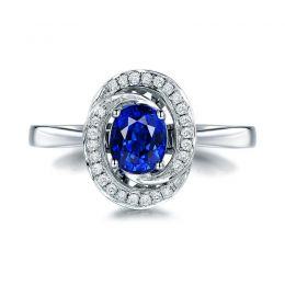 Bague saphir bleu. Or blanc, diamants myriade