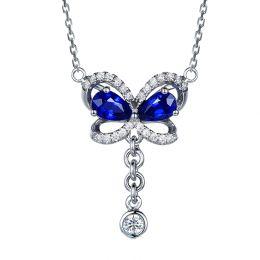 Pendentif papillon saphirs et diamants. Or blanc 18cts