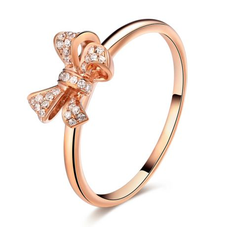 Bague petit noeud Or rose 18cts. Diamants 0.080ct