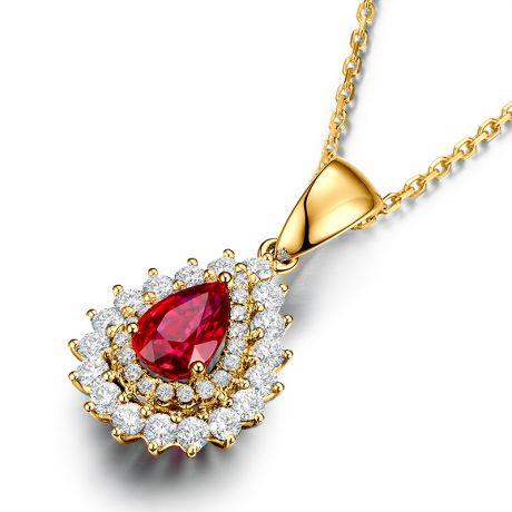Pendentif rubis rouge vif taillé poire. Diamants sertis et Or jaune