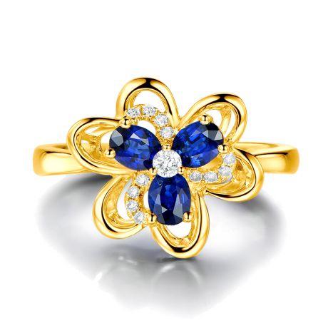 Bague fleur Or jaune fleur anémone. Diamants, saphirs