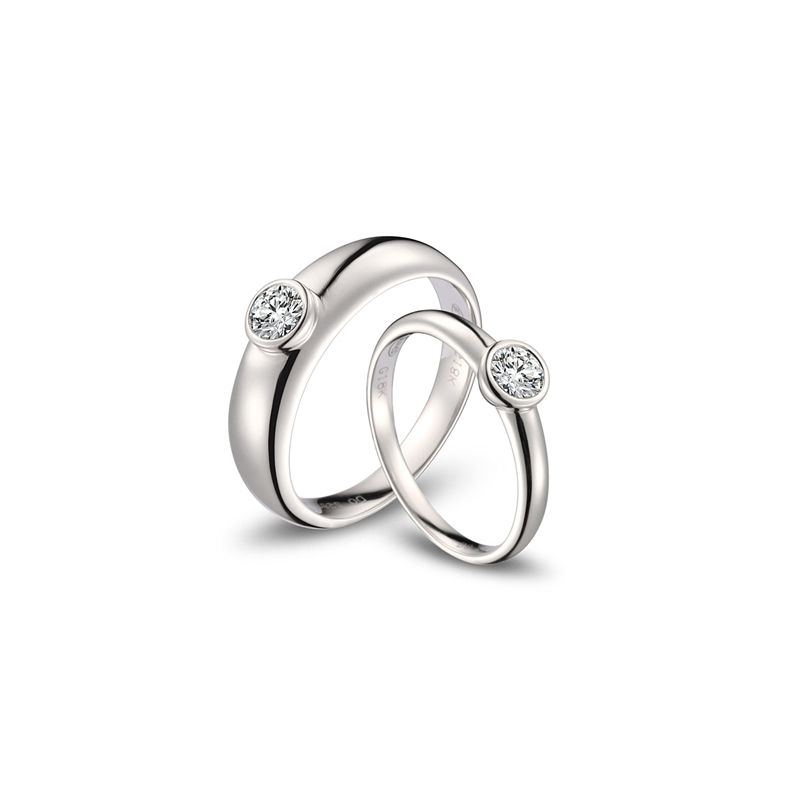 Alliances Couple. Or blanc. Diamants 0.60ct