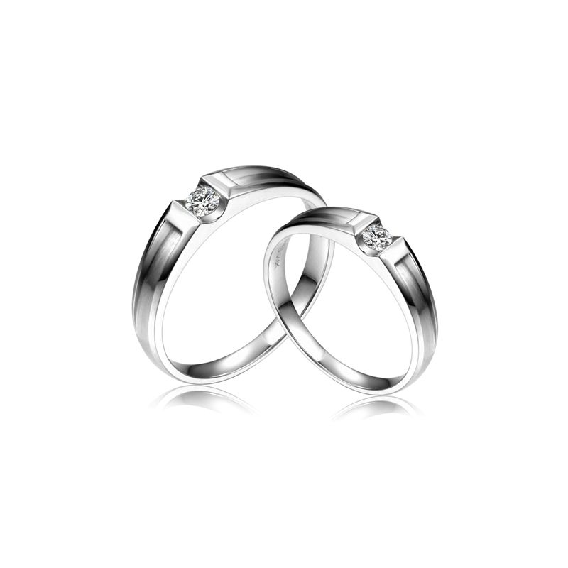 Alliances Couple. Or blanc. Diamants 0.160ct
