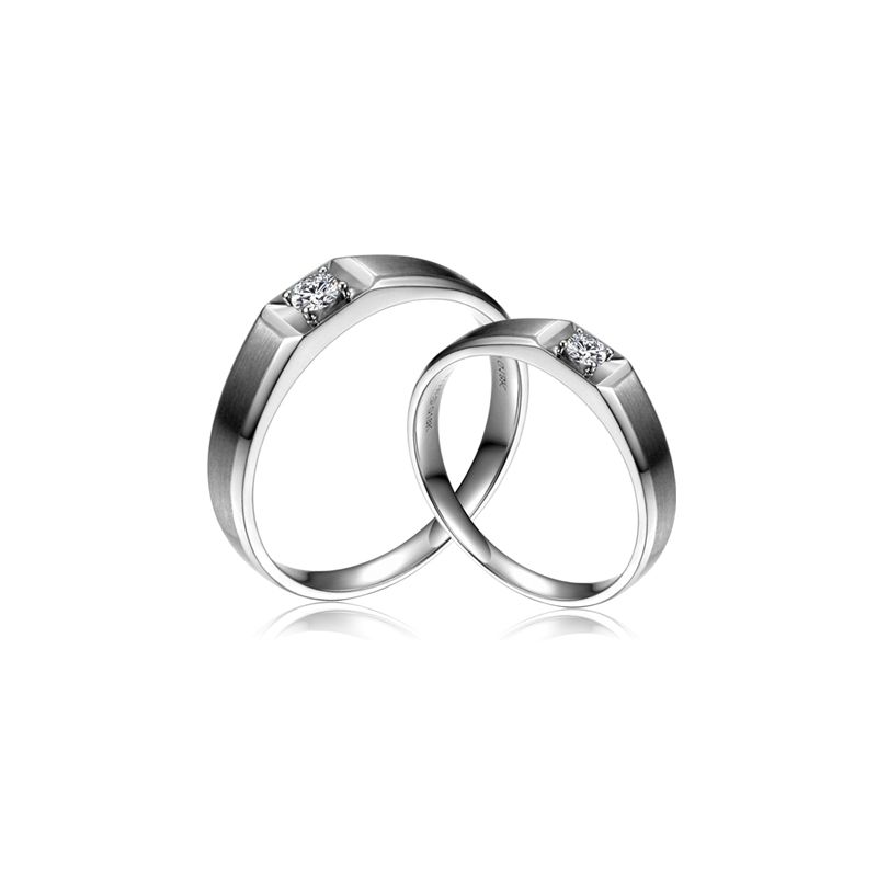 Alliances Couple. Or blanc. Diamants 0.200ct