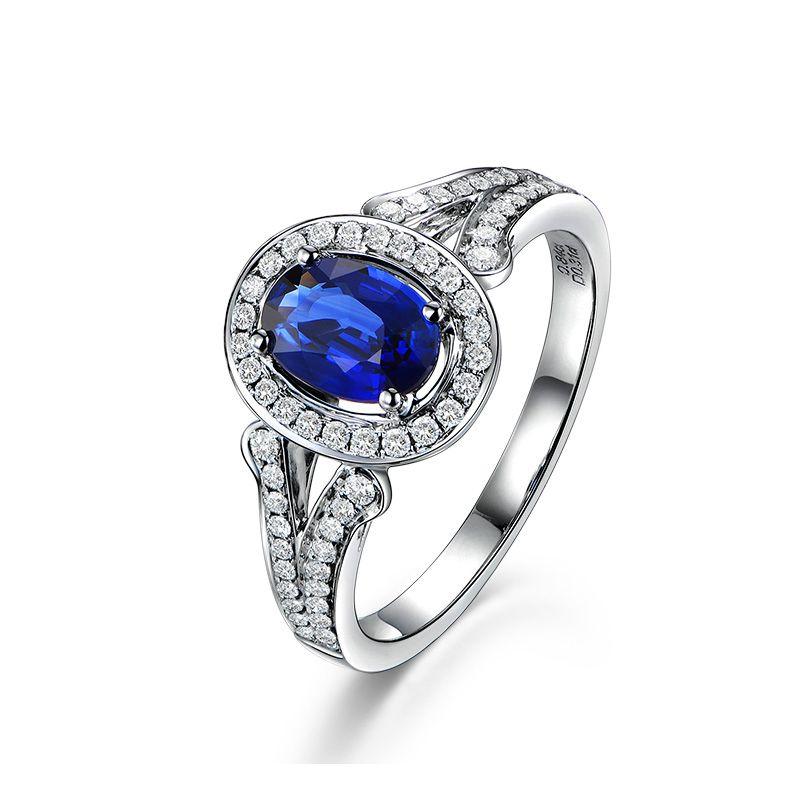 Bague fiançaille saphir ovale 1 carat. Or blanc. Pavage diamants