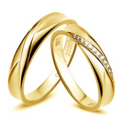 Alliance homme et femme en or jaune et diamants
